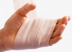 Hand being bandaged
