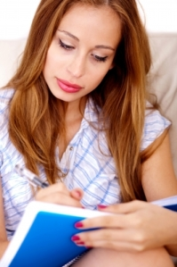 woman writing in notebook-fdp