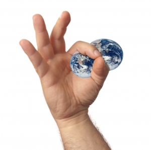 world being squeezed by hand