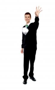 Schoolboy tossing paper
