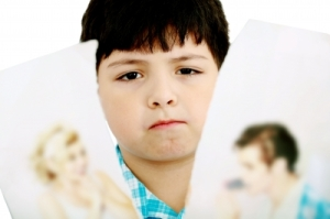 upset boy with picture of parents