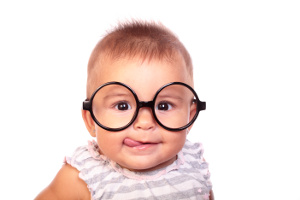 baby with glasses, looking clever