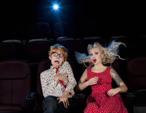 scared couple in movie theater